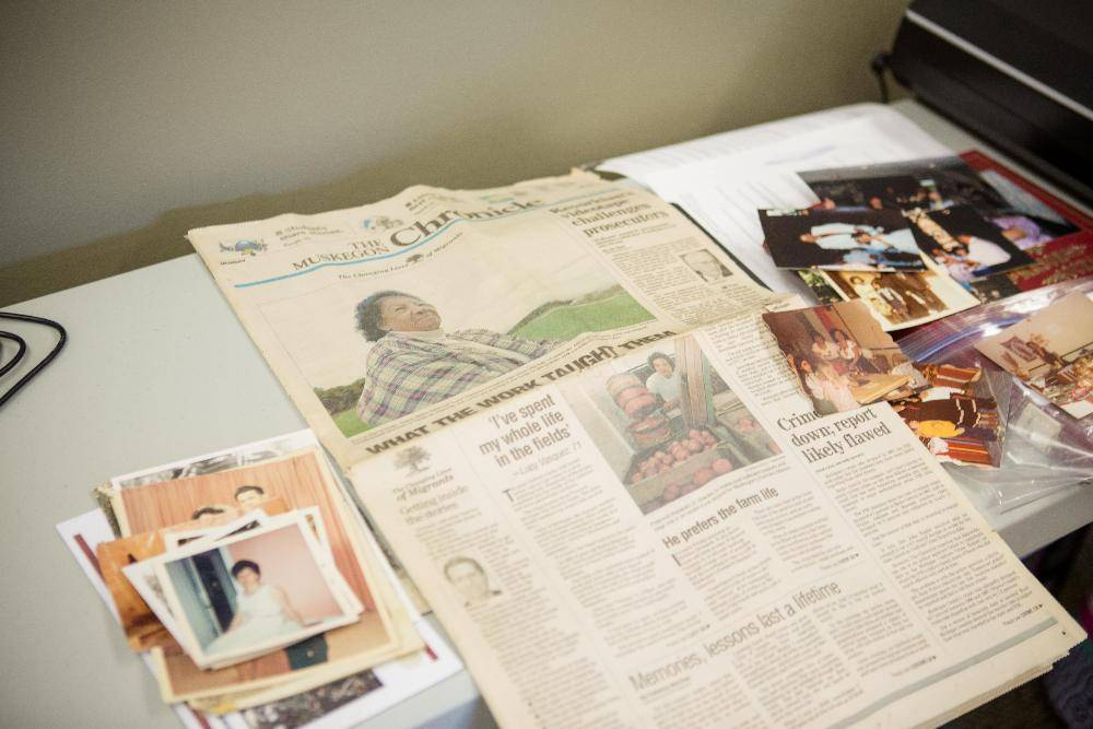 Newspaper clippings, photographic prints, and other family archival materials.